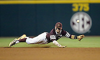 Texas A&M's Austin Homan (25) dives for a line drive agaisnt TCU during the eighth inning of a NCAA college baseball Super Regional tournament game, Saturday, June 11, 2016, in College Station, Texas. Texas A&M win 7-1 to even the series at 1-1. (AP Photo/Sam Craft)