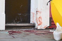 © Licensed to London News Pictures. 13/09/2019. London, UK. Large patched of blood in a doorway at the scene on Camden HIgh Street in North London where a man was last night stabbed to death and another man remains in hospital with a knife wound. Photo credit: Ben Cawthra/LNP