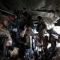 British soldiers of 3rd Battalion The Parachute Regiment on board a Chinook Ch-47 helicopter flying towards their target on an airborne assault as part of Operation 'Southern Beast'. Kandahar Province, Afghanistan on the 3rd of August 2008.