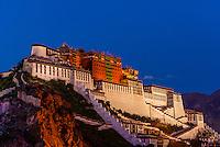 The Potala Palace illuminated at twilight, Lhasa, Tibet (Xizang), China.