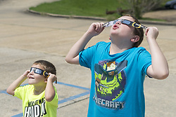 August 21, 2017 - Vernon, Alabama, USA - These two young kids were enjoying the solar eclipse on Monday Aug. 21st 2017, in Vernon, Alabama. (Credit Image: © Tim Thompson via ZUMA Wire)