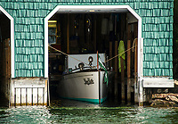 """A 1910 Goodhue and Hawkins 36' Laker """"Keen Kutter"""" owned by Dick and Patricia Hopgood sits at her slip on Cow Island, Lake Winnipesaukee, New Hampshire.  ©2018 Karen Bobotas Photographer"""