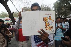 February 5, 2018 - Dhaka, Bangladesh - A boy showing Cricketer Shakib Al Hasan written a book name is ''Halum'' after buy in Ekushey Book Fair in Dhaka, Bangladesh. On February 5, 2018. (Credit Image: © Str/NurPhoto via ZUMA Press)