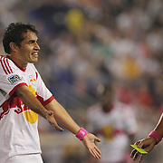 Fabian Espindola, New York Red Bulls, is booked by referee Fotis Bazakos after a tussle with AJ Soares, New England Revolution,  which led to both players receiving a yellow card during the New York Red Bulls V New England Revolution, Major League Soccer regular season match at Red Bull Arena, Harrison, New Jersey. USA. 5th October 2013. Photo Tim Clayton