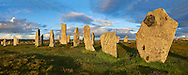 Panorama of the outer row of stones, 27 metres long,  leading to the central stone circle overlooking Loch Roag, circa 2900BC. Calanais Neolithic Standing Stone (Tursachan Chalanais) , Isle of Lewis, Outer Hebrides, Scotland. .<br /> <br /> Visit our SCOTLAND HISTORIC PLACXES PHOTO COLLECTIONS for more photos to download or buy as wall art prints https://funkystock.photoshelter.com/gallery-collection/Images-of-Scotland-Scotish-Historic-Places-Pictures-Photos/C0000eJg00xiv_iQ<br /> '<br /> Visit our PREHISTORIC PLACES PHOTO COLLECTIONS for more  photos to download or buy as prints https://funkystock.photoshelter.com/gallery-collection/Prehistoric-Neolithic-Sites-Art-Artefacts-Pictures-Photos/C0000tfxw63zrUT4
