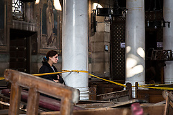 December 11, 2016 - Cairo, Egypt - A woman reacts to the damage inside the Coptic Cathedral after an explosion killed over 20 people on Dcember 11, 2016 in Cairo, Egypt (Credit Image: © Sima Diab via ZUMA Wire)