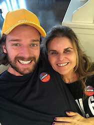 """Patrick Schwarzenegger releases a photo on Twitter with the following caption: """"""""Woke up early on @mariashriver birthday, went to the polls, voted, and now taking her off to lunch! Love u momma. Love u to moon and back! Happy b day"""""""". Photo Credit: Twitter *** No USA Distribution *** For Editorial Use Only *** Not to be Published in Books or Photo Books ***  Please note: Fees charged by the agency are for the agency's services only, and do not, nor are they intended to, convey to the user any ownership of Copyright or License in the material. The agency does not claim any ownership including but not limited to Copyright or License in the attached material. By publishing this material you expressly agree to indemnify and to hold the agency and its directors, shareholders and employees harmless from any loss, claims, damages, demands, expenses (including legal fees), or any causes of action or allegation against the agency arising out of or connected in any way with publication of the material."""