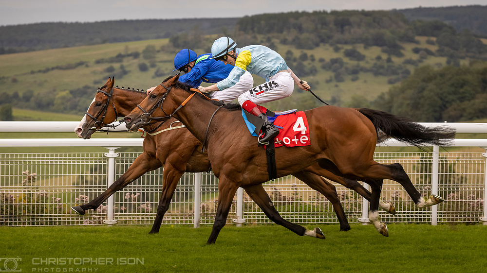 Joe Fanning on Dancing Kings beats David Egan on Nagano (4) in the Tote March Stakes at Goodwood Racecourse.<br /> Picture date: Saturday August 28, 2021.<br /> Photograph by Christopher Ison ©<br /> 07544044177<br /> chris@christopherison.com<br /> www.christopherison.com<br /> <br /> IMPORTANT NOTE REGARDING IMAGE LICENCING FOR THIS PHOTOGRAPH: This image is supplied to the client under the terms previously agree. No sales are permitted unless expressly agreed in writing by the photographer.
