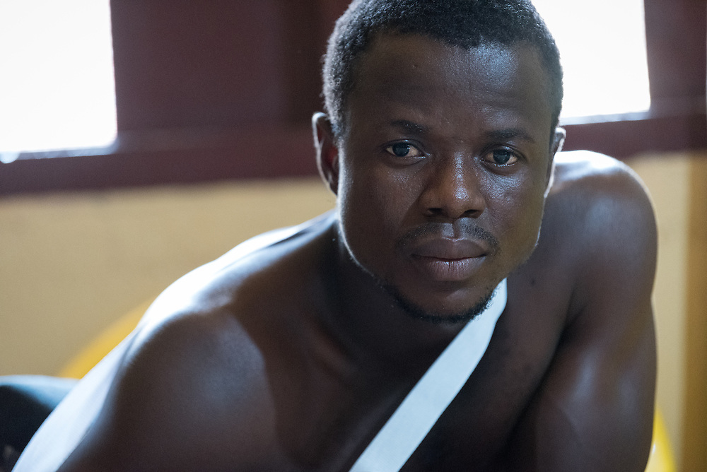 2 November 2019, Ganta, Liberia: 27-year-old John Kwekeh is receiving treatment at Ganta Hospital for a dislocated shoulder. He was brushing grass near his home when he injured his arm. Located in Nimba county, the Ganta United Methodist Hospital serves tens of thousands of patients each year. It is a founding member of the Christian Health Association of Liberia.