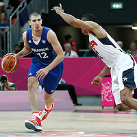 29 July 2012: Nando De Colo of France brings the ball upcourt against USA Russell Westbrook during the 98-71 Team USA victory over Team France, during the men's basketball preliminary, at the Basketball Arena, in London, Great Britain.