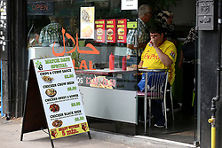 """A Watford fan grabs a bite to eat before the Premier League match at Vicarage Road, Watford. PRESS ASSOCIATION Photo. Picture date: Saturday August 11, 2018. See PA story SOCCER Watford. Photo credit should read: Nigel French/PA Wire. RESTRICTIONS: EDITORIAL USE ONLY No use with unauthorised audio, video, data, fixture lists, club/league logos or """"live"""" services. Online in-match use limited to 120 images, no video emulation. No use in betting, games or single club/league/player publications."""