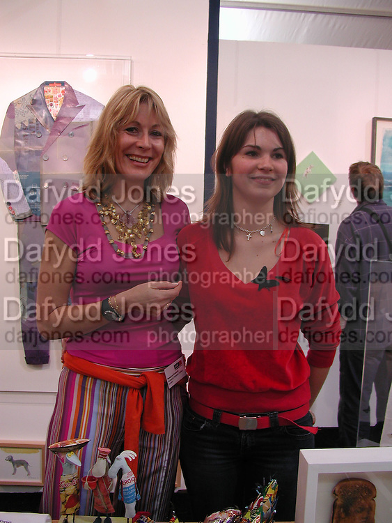 Rebecca Hossack and Lady Amy Frost ( terry Frost's daughter) , The Affordable Art Fair private view ( in aid of Barnados) Battersea. 19 March 2003. © Copyright Photograph by Dafydd Jones 66 Stockwell Park Rd. London SW9 0DA Tel 020 7733 0108 www.dafjones.com