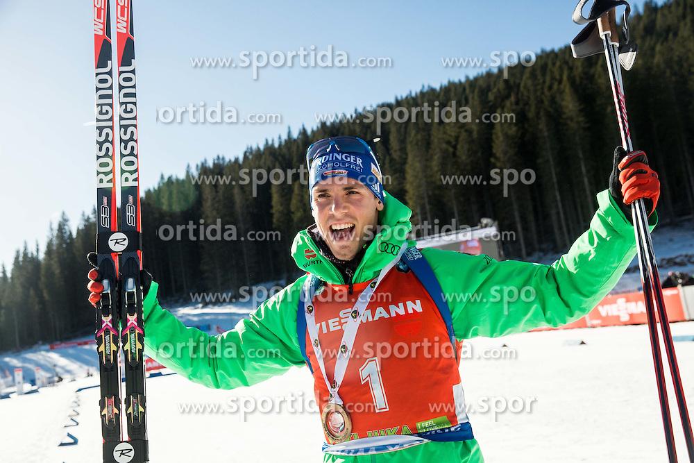 Winner Simon Schempp (GER) celebrates at medal ceremony after the Men 12,5 km Pursuit at day 3 of IBU Biathlon World Cup 2015/16 Pokljuka, on December 19, 2015 in Rudno polje, Pokljuka, Slovenia. Photo by Vid Ponikvar / Sportida