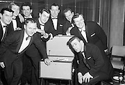 The Regal Showband, Cork, listen to their first recording 'Love Me', released under the King label. .L to R, back row: Kevin Lynch, Mike Ahern, Gordon Hanley, vocalist Declan Ryan, Paddy Kennedy (Manager), Benno Haussmann . Front left is band leader John Minehane, and seated, right is Jimmy Cotter. .09.11.1964