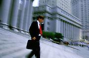 NY, New York City, Businessman running down steps