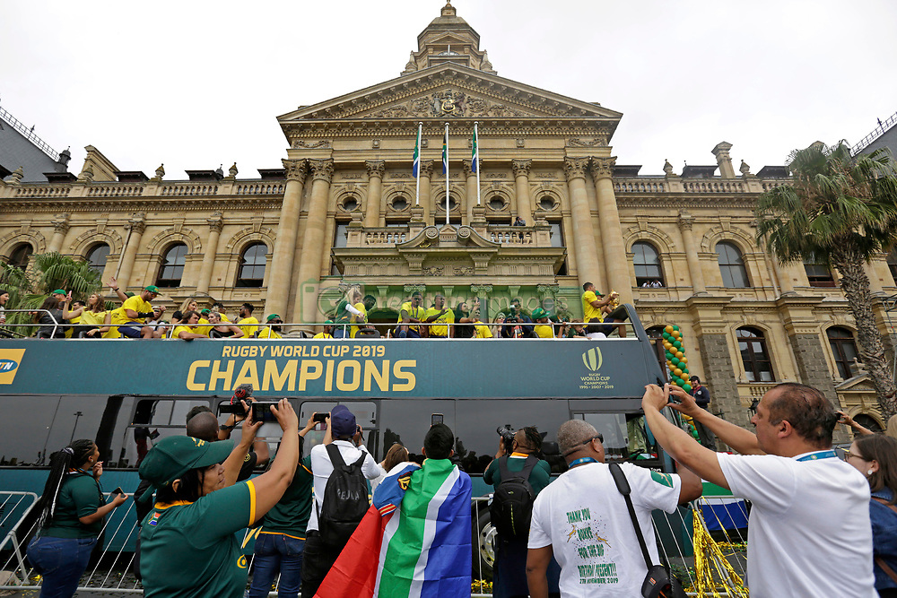 Monday 11th November 2019.<br /> City Hall, Grand Parade,<br /> And City Centre, Cape Town,<br /> Western Cape,<br /> South Africa.<br /> <br /> SPRINGBOKS CELEBRATE WINNING THE RUGBY WORLD CUP CHAMPIONSHIP IN 2019 WITH A COUNTRYWIDE VICTORY TOUR!<br /> <br /> SPRINGBOKS RUGBY WORLD CUP VICTORY TOUR CAPE TOWN!<br /> <br /> Excited fans on Cape Town's Grand Parade celebrate the Springboks as they drive past in their open top bus outside the Cape Town City Hall.<br /> <br /> The reigning Rugby World Cup Champions namely the South African Springbok Rugby Team, celebrates winning the Webb Ellis Cup during the International Rugby Football Board Rugby World Cup Championship held in Japan in 2019 with their Victory Tour that culminated in the final city tour taking place in Cape Town. Thousands of South African fans filled the streets of the city all trying their best to show their support for their beloved Springboks and to celebrate them winning the Rugby World Cup for the third time. South Africa previously won the Rugby World Cup in 1995, 2007 and now again in 2019. South African Springbok Captan Siya Kolisi took the opportunity to speak to the gathered crowd about how something like this brings unity and that we should live together as a nation that practices what is known as ubuntu. Ubuntu is a quality that includes the essential human virtues of compassion and humanity. This image taken in Cape Town on Monday 11th November 2019.<br /> <br /> This image is the property of Seven Bang Media Group (Pty) Ltd, hereinafter referred to as SBM.<br /> <br /> Picture By: SBM / Mark Wessels. (11/11/2019).<br /> +27 (0)61 547 2729<br /> mark@sevenbang.com<br /> www.sevnbang.com<br /> <br /> Copyright © SBM. All Rights Reserved.