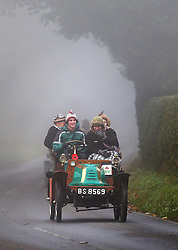 © Licensed to London News Pictures. 01/11/2015. Staplefield, UK. A 1901 Darracq drives along a foggy road near Staplefield as it takes part in the London to Brighton Veteran Car Run.  Photo credit: Peter Macdiarmid/LNP