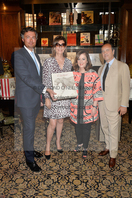 Left to right,  LAURENT FENIOU, MARTINE ASSOULINE, VIVIENNE BECKER and PROSPER ASSOULINE at a party to celebrate the publication of Cartier's Panthere book at Maison Assouline, Picadilly, London on 7th September 2015