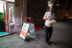 © Licensed to London News Pictures . 26/09/2017. Brighton, UK. A man with a takeaway outside a takeaway restaurant on Brighton Promenade . Revellers at the end of a night out in Brighton during Freshers week , when university students traditionally enjoy the bars and clubs during their first nights out in a new city . Photo credit: Joel Goodman/LNP
