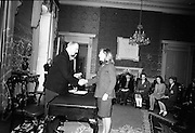 28/04/1966<br /> 04/28/1966<br /> 28 April 1966<br /> President Eamon de Valera presents prizes at Aras an Uachtarain. The President presented the prizes to the winners of competitions for schoolchildren organised by the Golden Jubilee 1916 Committee. The winners from schools all over Ireland competed in competitions for essays and poetry in Irish and English. Picture shows President de Valera presenting 1st prize of £50 in Aiste Gaeilge competition to Rosie Ni Mhisteil, 63, Cearnog Muirfean, Baile Atha Cliath, a pupil of Colaiste Alexandra.