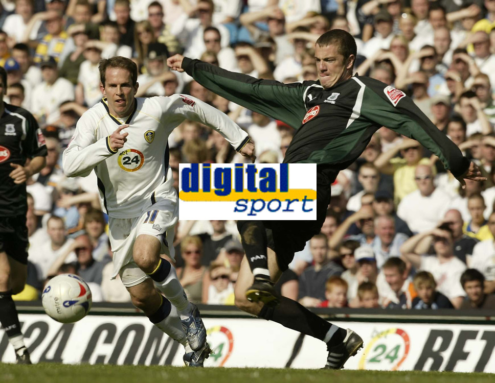 Photo: Aidan Ellis.<br /> Leeds United v Plymouth Argyle. Coca Cola Championship. 07/04/2007.<br /> Leeds Eddie Lewis (L) chases down Plymouth's Paul Connolly