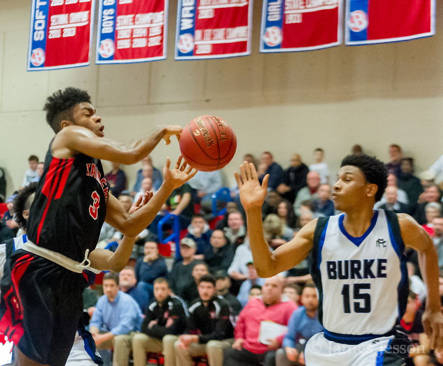 Watertown High School senior Julio Fulcar tries to keep the ball from Jeremiah E. Burke High School senior McCarthy Akinkouye during the MIAA Division 3 state semifinal game in Burlington, March 14, 2018. The Raiders won the game, 66-61. [Wicked Local Photo/James Jesson]