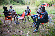 A group of African migrants in Lakaxita. Irun (Basque Country) August 30, 2018. Lakaxita is a self-managed socio-cultural space located in an occupied house, where volunteers have created a hosting network for migrants in transit who have already completed the 5-day period that can remain in public resources. This group of volunteers is avoiding a serious humanitarian problem Irún, the Basque municipality on the border with Hendaye. As the number of migrants arriving on the coasts of southern Spain incresead, more and more migrants are heading north to the border city of Irun. (Gari Garaialde / Bostok Photo)