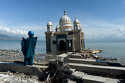 Oct. 8, 2018 - Palu, Sulawesi, Indonesia - A woman stands near debris of mosque seen on Talise beach in  Palu, Central Sulawesi. At least 1.994 people have died after a series of powerful earthquake which triggered a tsunami hit Central Sulawesi. (Credit Image: © Agung Kuncahya B/Xinhua via ZUMA Wire)