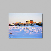 Alaska. Anchorage in winter.  Downtown from snow covered frozen Cook Inlet.