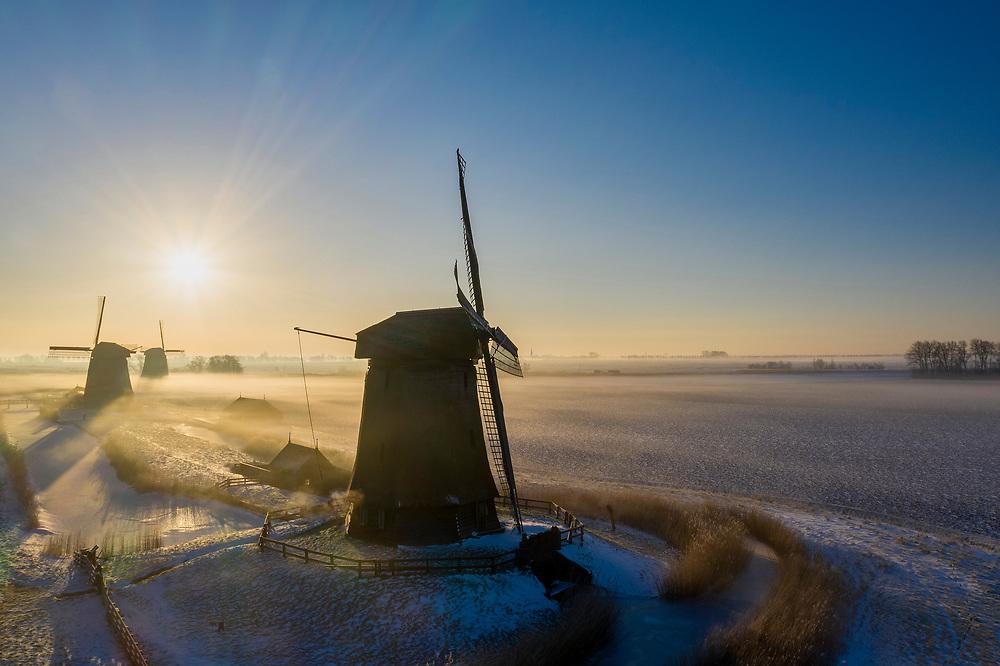 Nederland, Noord-Holland, Schermerhorn; 22-02-2021; Schermer, Noordervaart. Molengang bij zonsopkomst.<br /> Windmill  network polder Schermer at sunrise.<br /> drone-opname (luchtopname, toeslag op standaard tarieven);<br /> drone recording (aerial, additional fee required);<br /> copyright foto/photo Siebe Swart