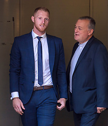 © Licensed to London News Pictures. 10/08/2018. Bristol, UK. BEN STOKES (left) leaves Bristol Crown court at lunchtime today for the fourth day of his trial on charges of affray that relate to a fight outside a Bristol nightclub on September 25 2017. England cricketer Ben Stokes and two other men, Ryan Ali, 28, and Ryan Hale, 27, all deny the charge. Stokes, Ali and Hale are jointly charged with affray in the Clifton Triangle area of Bristol on September 25 last year, several hours after England had played a one-day international against the West Indies in the city. A 27-year-old man allegedly suffered a fractured eye socket in the incident. Photo credit: Simon Chapman/LNP