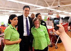 © Licensed to London News Pictures. 28/11/2011, Clapham, UK. ED MILIBAND, Leader of the Labour Party. poses with staff from the superstore after he holds a question and answer session in an Asda supermarket in Clapham, London, today 28 November 2011. The session is ahead of the Chancellors Autumn Statement tomorrow (29 Nov). Photo credit : Stephen Simpson/LNP