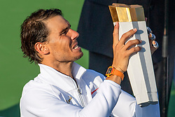 August 12, 2018 - Toronto, ON, U.S. - TORONTO, ON - AUGUST 12: Rafael Nadal of Spain hoists his trophy as he celebrates his victory over Stefanos Tsitsipas of Greece after their Men's Final match at the Rogers Cup Sunday, August 12, 2018 at Aviva Centre in Toronto, Ontario Canada. Nadal defeated Tsitsipas 6-2, 7-6. (Photo by Jeff Chevrier/Icon Sportswire) (Credit Image: © Jeff Chevrier/Icon SMI via ZUMA Press)