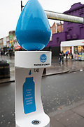 Free drinking water fountain on Camden High Street on 14th January 2020 in London, England, United Kingdom. The Mayor of London partnered with Thames Water to install a network of more than 100 drinking water fountains in busy and accessible areas. The fountains are part of measures taken to reduce the single-use plastic water bottles and to provide free access to healthy tap water.