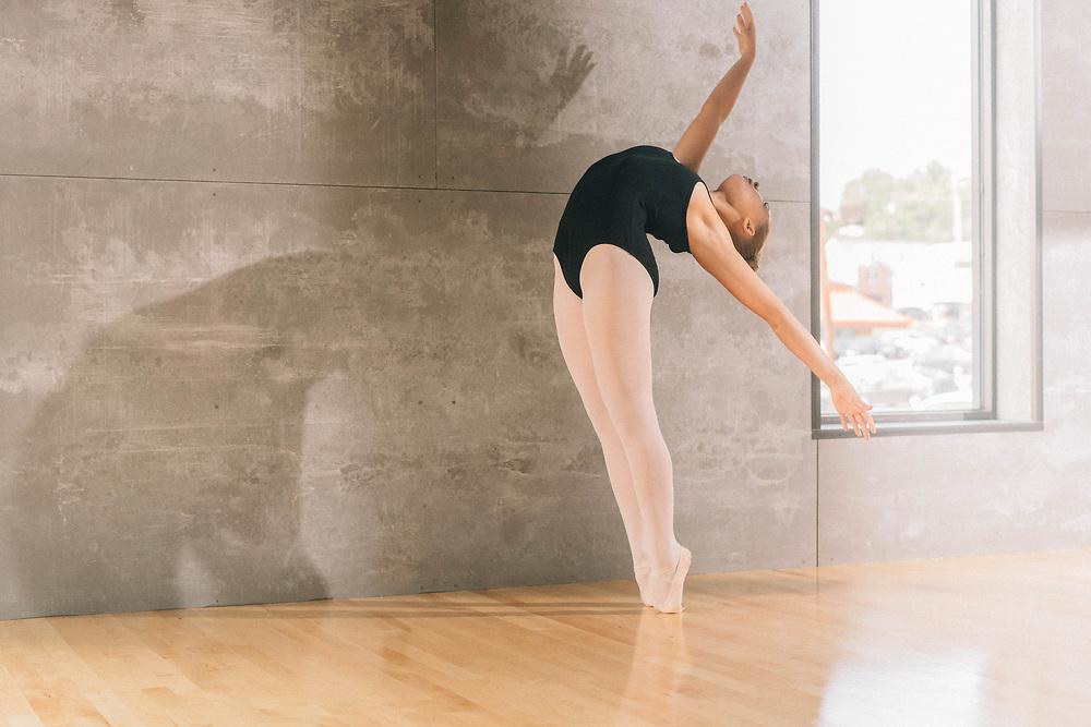 Ballerina dancing along the wall