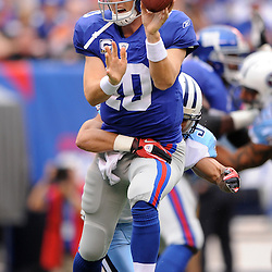 Quarterback Eli Manning #10 of the New York Giants shovel passes the ball with his off left hand during first half NFL football action between the New York Giants and Tennessee Titans at New Meadowlands Stadium in East Rutherford, New Jersey. The game is tied at half time.