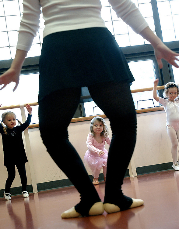 Val1/2/03  Photo by Mara Lavitt-Kid ballet 1<br /> ML0044F #5307<br /> Julie Altieri of Trumbull (the legs) leads her 3-year-old tap & ballet class at the Shelton Senior Center.  Pupils are Emily Giovannone age 3 left, Sarah White age 3 center, and Gabby Rago age 4 right.