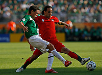 Photo: Glyn Thomas.<br />Mexico v Iran. Group D, FIFA World Cup 2006. 11/06/2006.<br /> Mexico's Guillermo Franco (L) and Iran's Ali Karimi.