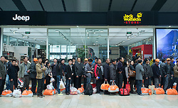 Passengers queuing in in new modern Beijing South Railway Station in China