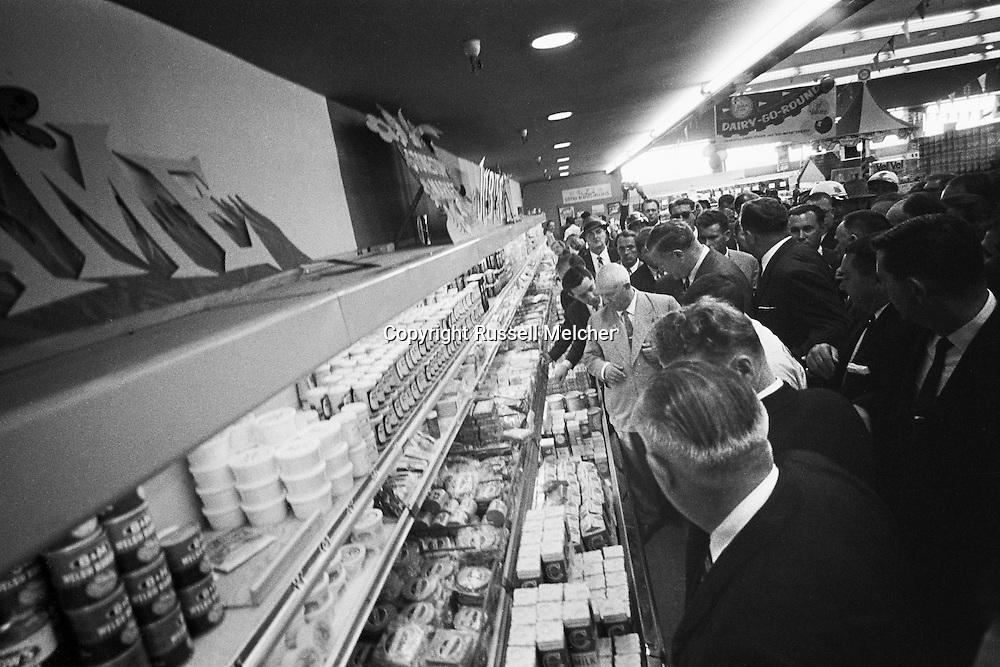 September 21, 1959. Nikita Khrushchev  admiring fabulous selection of US cheese counter. I am standing on the cheese counter to get this picture.<br /> <br /> 21 Septembre 1959. Nikita Khrouchtchev admirant la fabuleuse sélection de fromage américain. J'ai du monter sur le comptoir de fromage ( et en ecraser quelques un au passage) pour obtenir cette image .