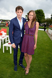 EDDIE REDMAYNE and HANNAH BAGSHAWE at the Audi International Polo at Guards Polo Windsor Great Park, Egham, Surrey on 28th July 2013.