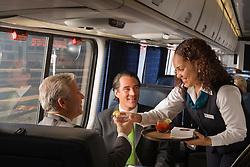 passengers on a train enjoying the train experience