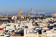 Rooftops of buildings looking towards the port and new bridge  from cathedral roof, Cadiz, Spain