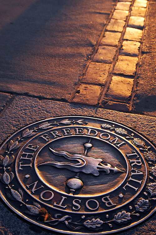 The sun sets over the Freedom Trail in Boston's North End.