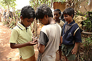 Budhia Singh, (left) 6, the famous Limca World Record marathoner, is sharing balloons with his friends near his house inside Salia Sahi slum (pop. 30.000) of Bhubaneswar, the capital of Orissa State, on Friday, May 16, 2008. On May 1, 2006, Budhia completed a record breaking 65 km run from Jagannath temple, Puri to Bhubaneswar. He was accompanied by his coach Biranchi Das and by the Central Reserve Police Force (CRPF). On 8th May 2006, a Government statement had ordered that he stopped running. The announcement came after doctors found the boy had high blood pressure and cardiological stress. As of 13th August 2007 Budhia's coach Biranchi Das was arrested by Indian police on suspicion of torture. Singh has accused his coach of beating him and withholding food. Das says Singh's family are making up charges as a result of a few petty rows. On April 13, Biranchi Das was shot dead in Bhubaneswar, in what is believed to be an event unconnected with Budhia, although the police is investigating the case and has made an arrest, a local goon named Raja Archary, which is now in police custody. **Italy and China Out**