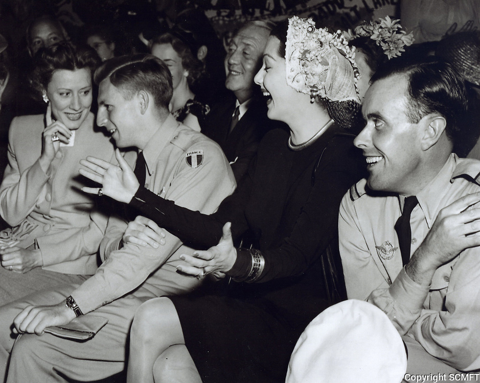 1944 Irene Dunne & Maria Montez watch the entertainment at the Hollywood Canteen