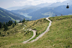 Two mountain bikers riding on uphill, Zillertal, Tyrol, Austria