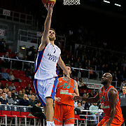 Anadolu Efes's Stratos Perperoglou (L) and Banvit's Keith Simmons (R) during their Turkish Basketball League match Anadolu Efes between Banvit at Abdi Ipekci Arena in Istanbul Turkey on Sunday 29 March 2015. Photo by Aykut AKICI/TURKPIX