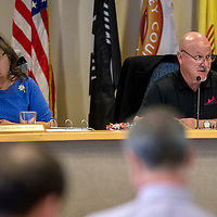 County Commissioners Carol Bowman-Muskett, left, Bill Lee and Genevieve Jackson (not pictured) begin a county commission meeting at the McKinley County Courthouse in Gallup Tuesday. The County Commission voted Tuesday to approve a restriction on early sales of liquor in the county.