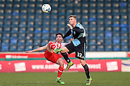 Jason McCarthy of Wycombe Wanderers Charlie Lee of Stevenage both attempt to go for the ball. Skybet football league two match, Wycombe Wanderers  v Stevenage Town at Adams Park  in High Wycombe, Buckinghamshire on Saturday 12th March 2016.<br /> pic by John Patrick Fletcher, Andrew Orchard sports photography.
